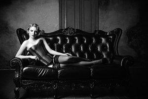 Sensual young girl lying on sofa. BW
