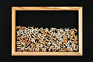 Wooden letters in a wooden frame on