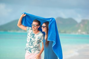 Young couple at tropical beach under
