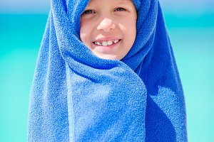 Adorable little girl wrapped in towe