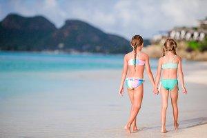 Kids having fun at tropical beach du