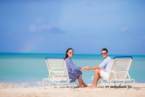 Couple relax on a tropical beach at