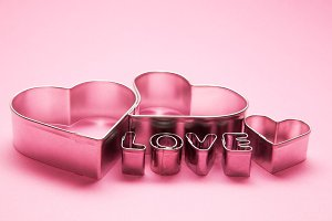 Heart shaped forms and 'love' text