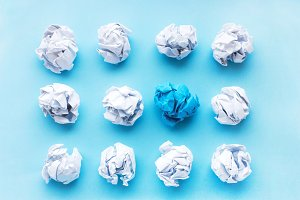 blue wrinkled ball of paper among th