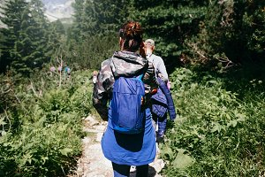 Travelers backpack walking forest