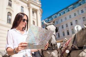 Young woman with a city map in city.