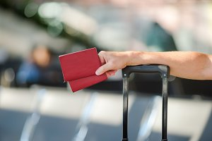 Closeup of man holding passports and