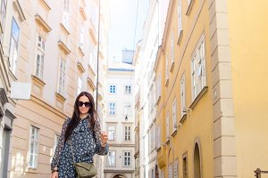 Woman walking in city. Young attract