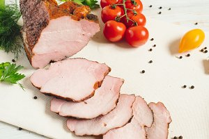 Traditional smoked meat on table