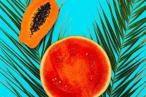 Watermelon and papaya on blue backgr