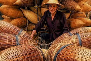 Old Vietnamese male craftsman standi
