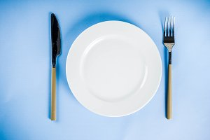 Table with a plate, fork and knife