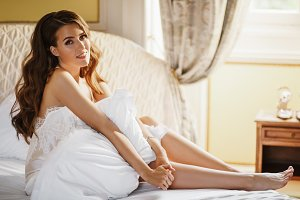 Lonely bride sits on the bed