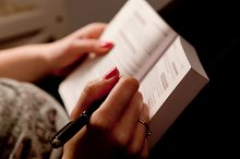 Woman making notes in a book