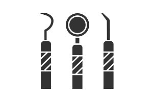 Dental instruments glyph icon
