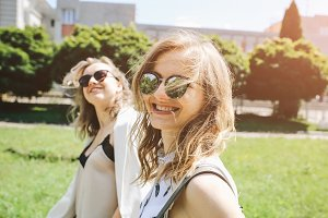 Two stylish hipster girls in glasses