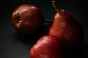 Red pears over dark background