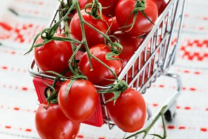 Cherry tomatoes in shopping basket