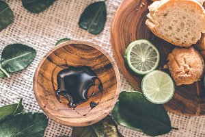 Soy sauce in the teak wooden saucer