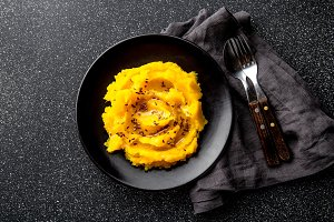 Mashed potato with pumpkin in black