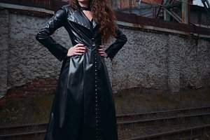 Beautiful goth girl in leather coat