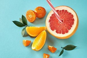Flat lay exotic citrus fruits with