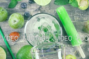Slow motion fruit drink with ice top