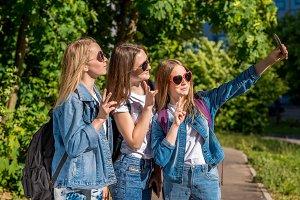 Three girls are teenage girlfriends