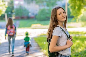 Girl schoolgirl. In the summer in
