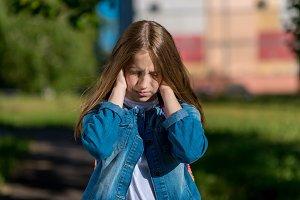 Little girl schoolgirl in summer