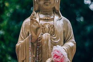 Golden Brown Buddhist Woman Statue