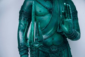 Green Buddhist Statue with a Sword