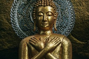 Mercy Golden Buddha Statue in Temple