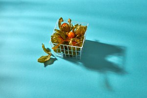 Ripe physalis with a peel in a
