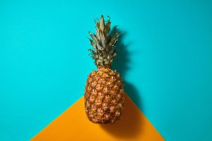 Fresh pineapple isolated on blue