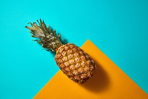 Tropical Pineapple fruit on a blue