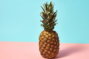 Ripe pineapple isolated on a blue
