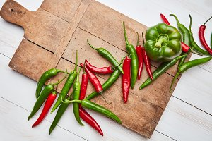 wooden board with colorful peppers