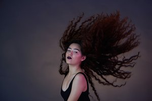 Brunette woman with flying hair