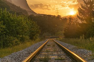 Railroad tracks at sunset, dusk