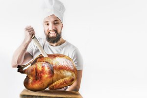 Chef with roasted whole turkey