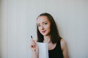 Girl with a Notepad and a pen