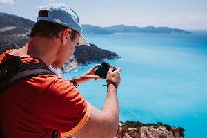 Man capture photograph of myrtos