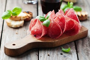 Delicious salami with basil