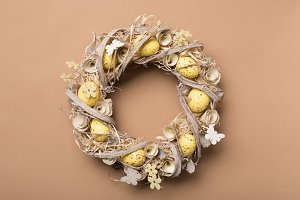 Easter wreath made of eggs om beige