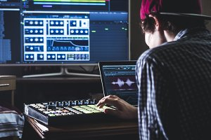 young male sound engineer working in