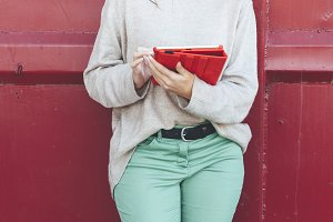 Millennial woman with red headphones