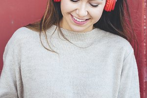 Smiling woman with red headphones
