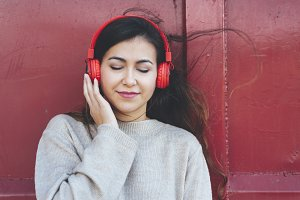 Portrait woman listening music