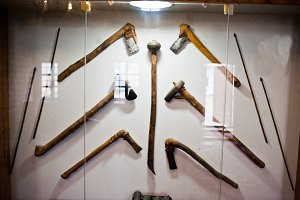 Medieval weapons or tools behind the